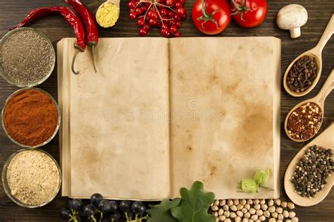 Open Vintage Book With Spices On Wooden Background